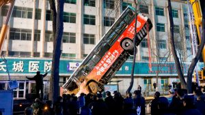 At least six dead as huge sinkhole swallows bus and pedestrians in China (photos)