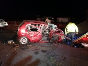 Car and truck collide leaving four injured.
