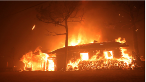 Mob burns house and four shacks after missing 8-year-old girl is found dead