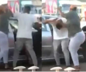 Woman fights her man as he attempts to prevent her from evicting the 'side chic' that was in his car (video)