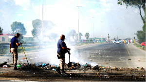 Cleaning company employees burn tyres and rubble in protest over unpaid salaries in Mitchells Plain